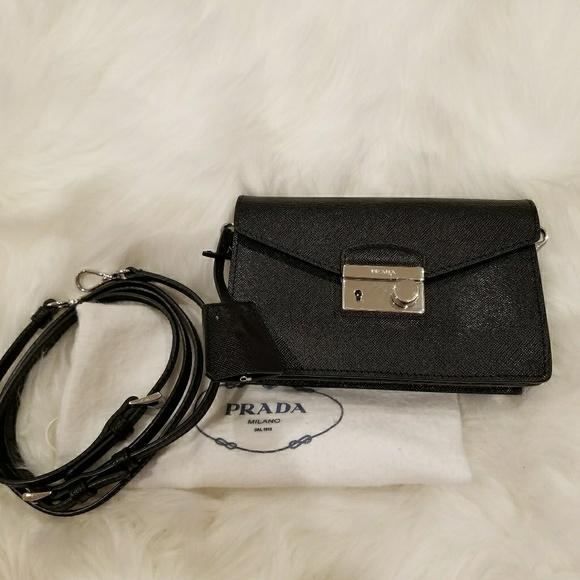 51ed754e1574 Authentic Prada mini Saffiano Sound crossbody. M_5a6ff0493b16083cf0802a7b